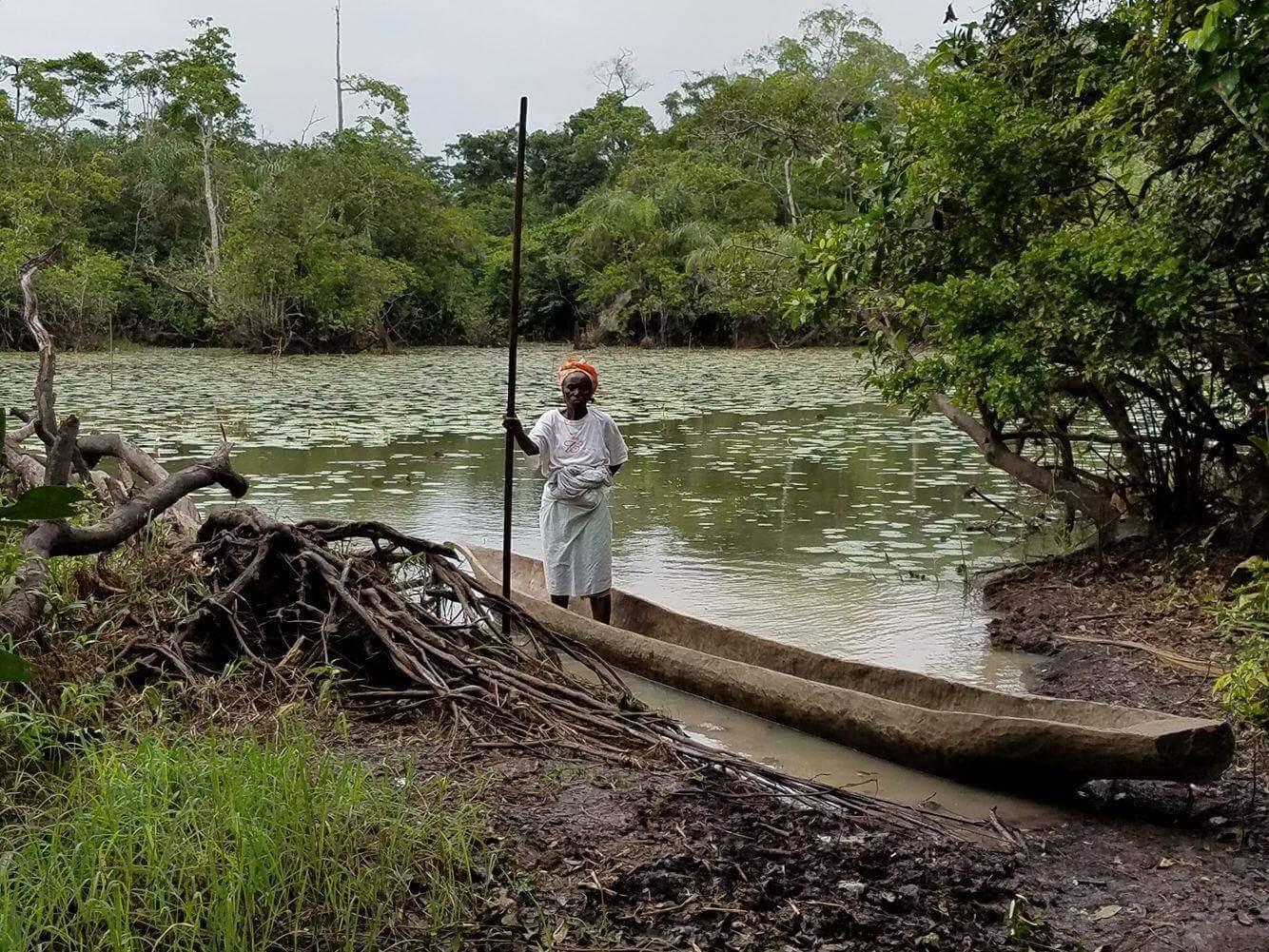 A woman on a canoe.