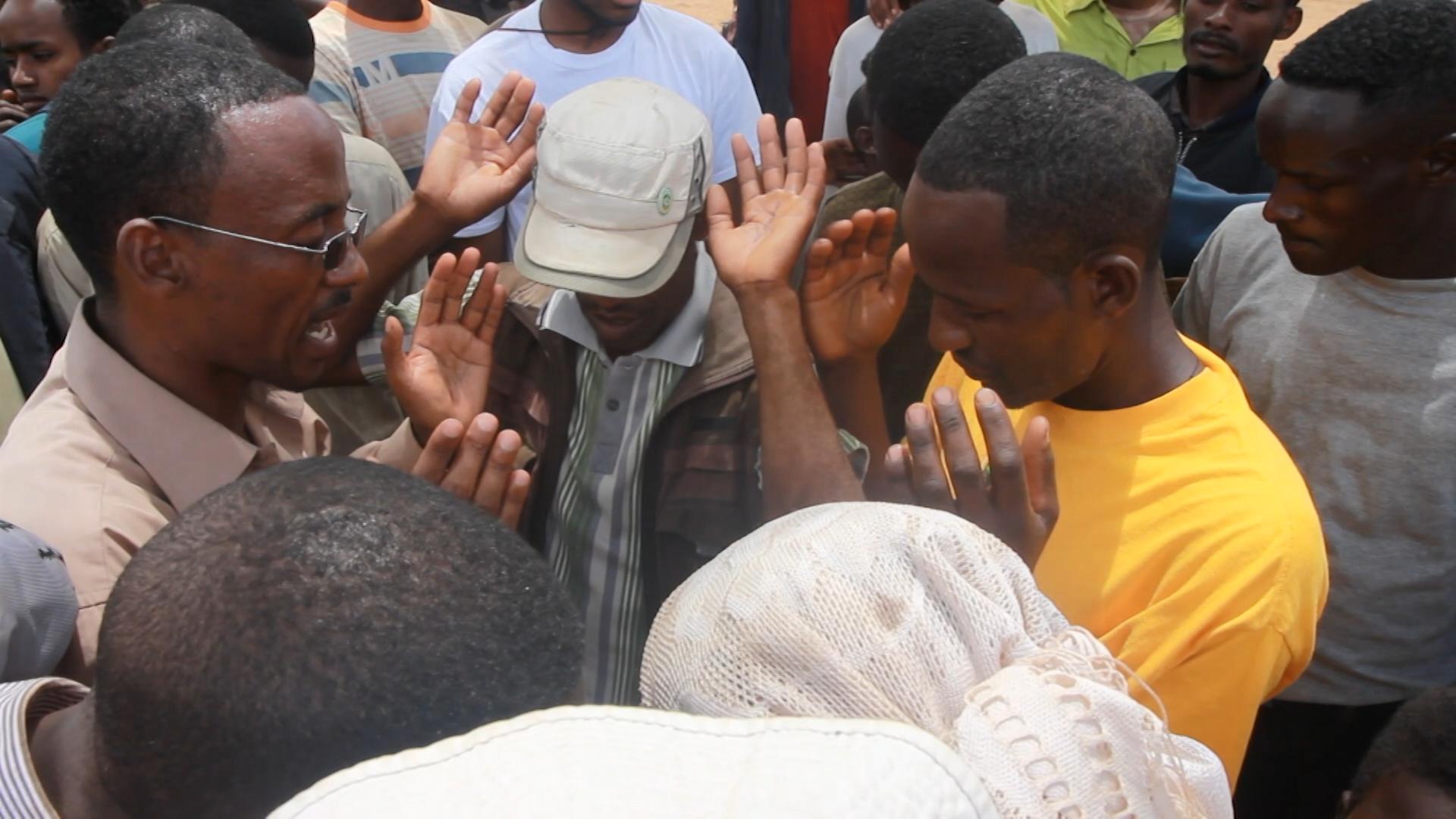 People praying.