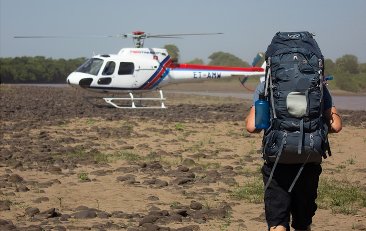 Helicopter picking up a missionary.
